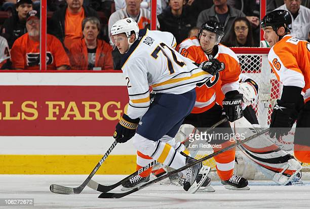 Luke Adam of the Buffalo Sabres skates in front of Danny Briere and Sean ODonnell of the Philadelphia Flyers on October 26 2010 at the Wells Fargo...
