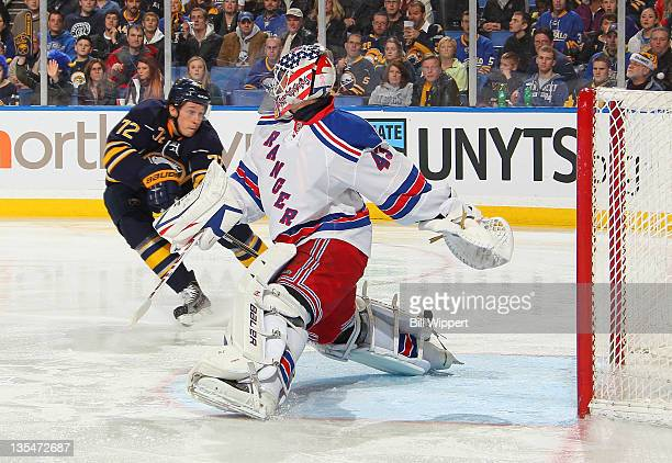 Luke Adam of the Buffalo Sabres tries but can not tip the puck past goaltender Martin Biron of the New York Rangers at First Niagara Center on...