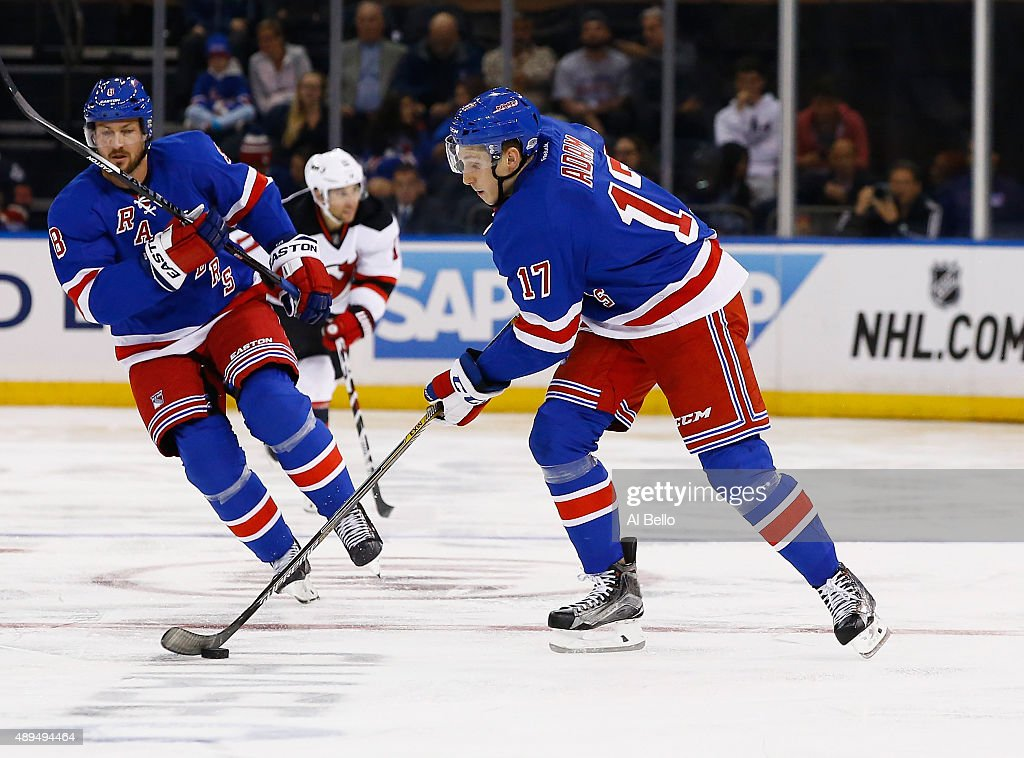 Luke Adam #17 of the New York Rangers skates against the New Jersey Devils during their Pre Season game at Madison Square Garden on September 21, 2015 in New York City.