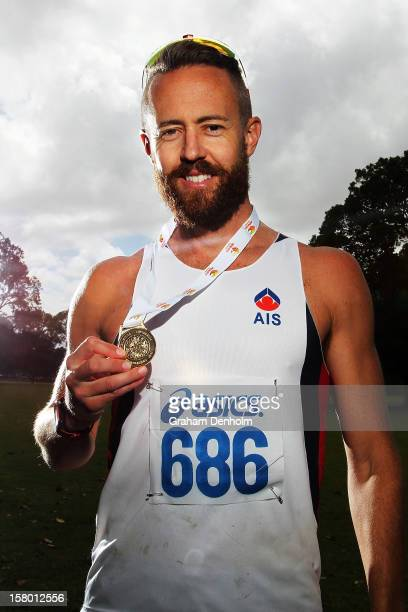 Luke Adams of New South Wales poses with his gold medal after victory in the Mens 50000 metre Race Walk Championship Open during the 50km race...