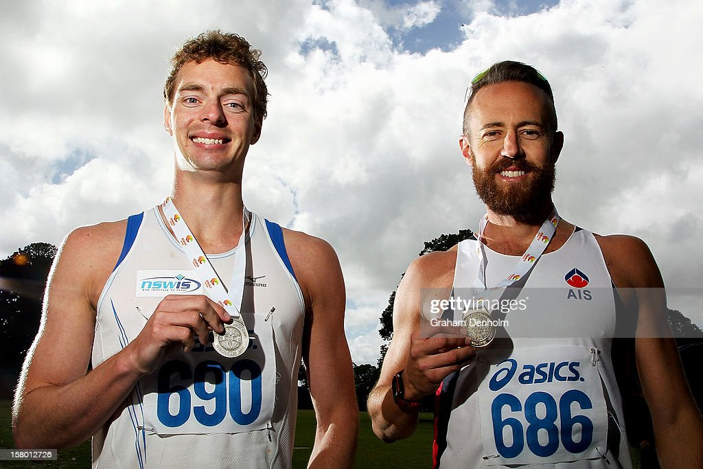 Luke Adams of New South Wales (R) poses with his gold medal and Ian Rayson of NSWIS poses with his silver medal following the Mens 50000 metre Race Walk Championship Open during the 50km race walking championships at Fawkner Park on December 9, 2012 in Melbourne, Australia.