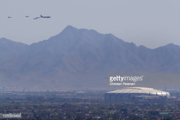 Luke AFB's 56th Fighter Wing and the 944th Fighter Wing and Arizona National Guard's 161st Air Refueling Wing flyover State Farm Stadium seen from...