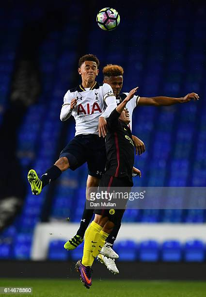 Luke Amos and Anton Walkes of Tottenham Hotspur battle for the ball against Brahim Diaz of Manchester City during the Premier League 2 match between...