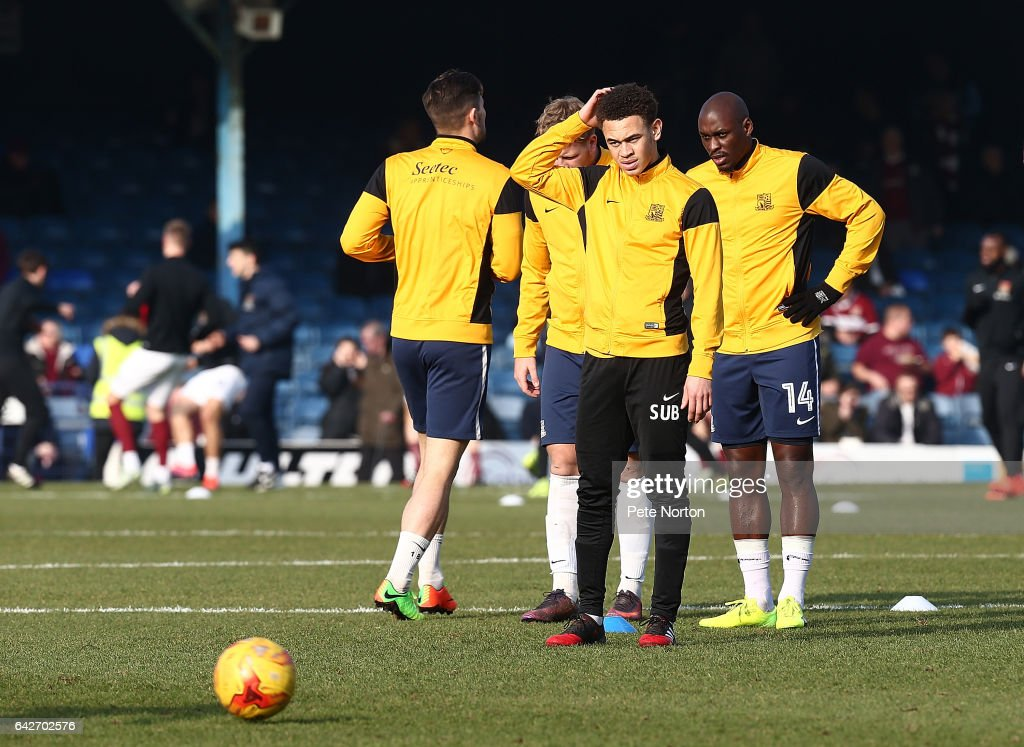 Luke Amos of Southend United looks on with team mate Marc-Antoine Fortune during the pre match warm up prior to the Sky Bet League One match between Southend United and Northampton Town at Roots Hall on February 18, 2017 in Southend, England.