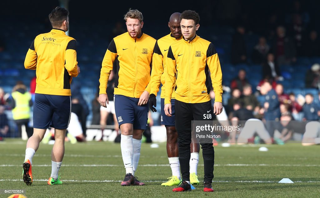Luke Amos of Southend United looks on with team mates Marc-Antoine Fortune and Adam Thompson during the pre match warm up prior to the Sky Bet League One match between Southend United and Northampton Town at Roots Hall on February 18, 2017 in Southend, England.