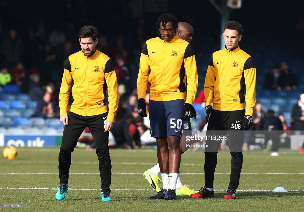 Luke Amos of Southend United looks on with team mates Michael Timlin and Nile Ranger during the pre match warm up prior to the Sky Bet League One match between Southend United and Northampton Town at Roots Hall on February 18, 2017 in Southend, England.