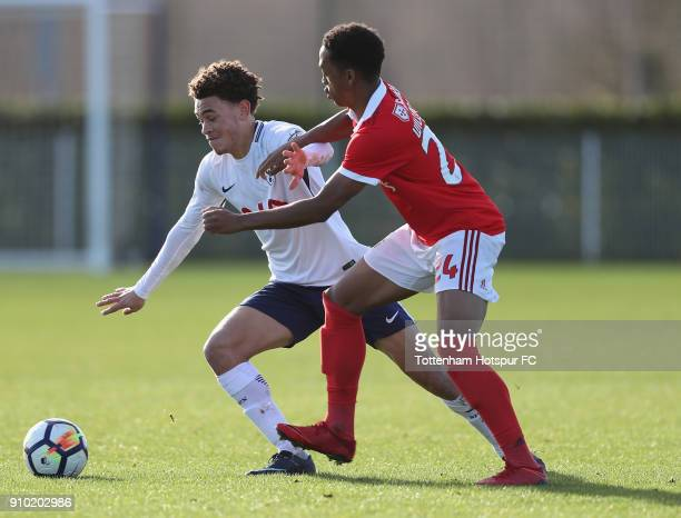 Luke Amos of Spurs battles with Christopher Willock of Benfica during the Premier League International Cup match between Tottenham Hotspur U23 and SL...