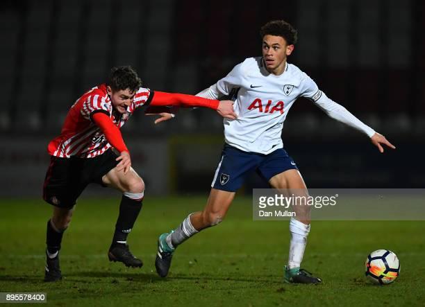 Luke Amos of Tottenham Hotspur holds off Elliot Embleton of Sunderland during the Premier League Two match between Tottenham Hotspur and Sunderland...