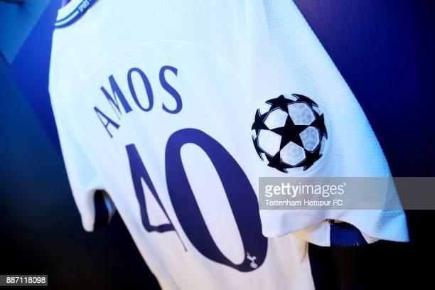 Luke Amos of Tottenham Hotspur shirt hangs in the Tottenham Hotspur changing room prior to the UEFA Champions League group H match between Tottenham...