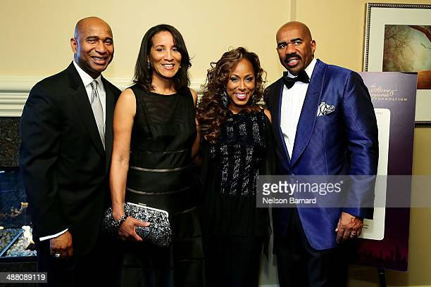 Luke and Kimberly Griffin of State Farm and Marjorie and Steve Harvey attend the 2014 Steve Marjorie Harvey Foundation Gala presented by CocaCola VIP...