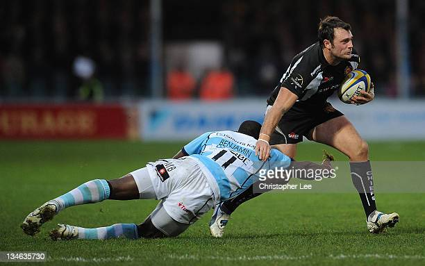 Luke Arscott of Exeter gets away from Miles Benjamin of Worcester during the AVIVA Premiership match between match between Exeter Chiefs and...
