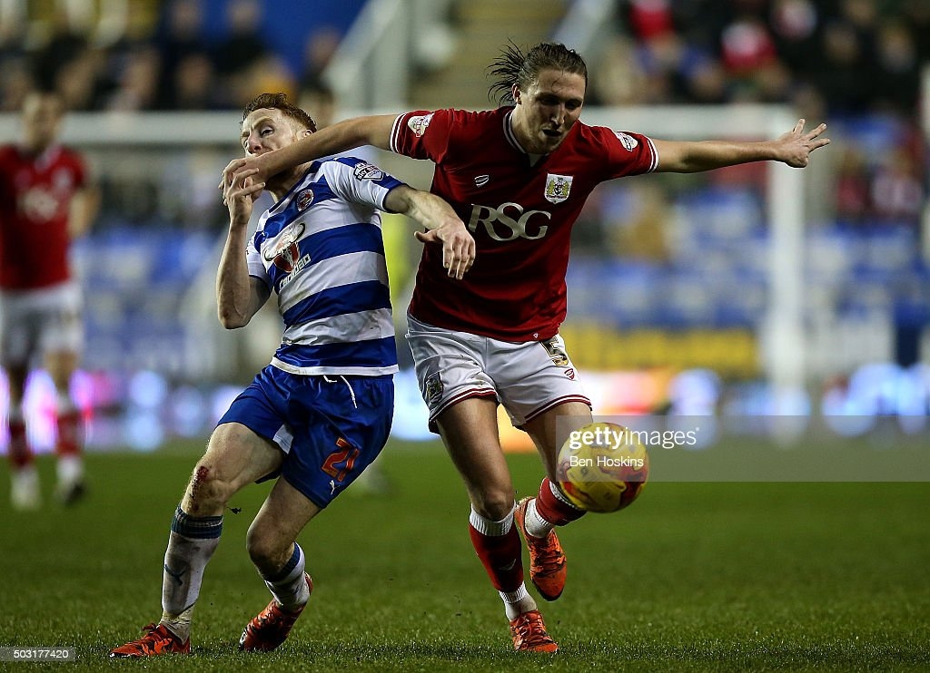 Luke Ayling of Bristol City holds off pressure from Stephen Quinn of Reading during the Sky Bet Championship match between Reading and Bristol City on January 2, 2016 in Reading, United Kingdom.
