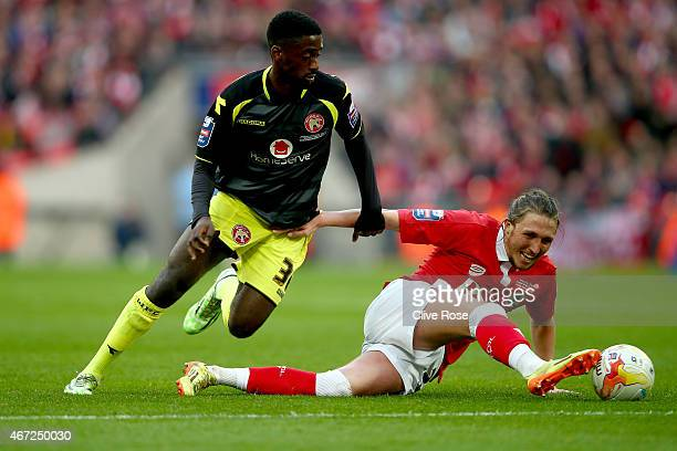 Luke Ayling of Bristol City is challenged by Jordy Hiwula of Walsall during the Johnstone's Paint Trophy Final between Bristol City and Walsall at...