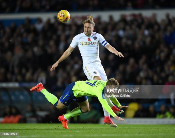 Luke Ayling of Leeds heads the ball away from Sam Winall of Derby County during the Sky Bet Championship match between Leeds United and Derby County...