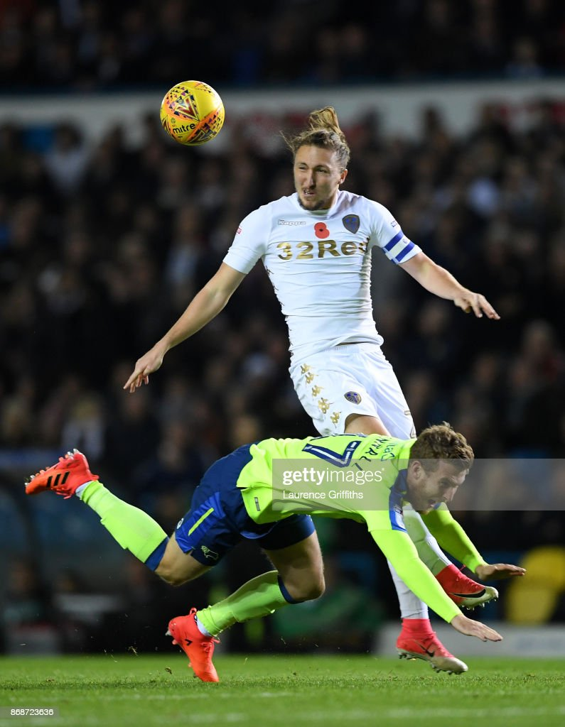 Luke Ayling of Leeds heads the ball away from Sam Winall of Derby County during the Sky Bet Championship match between Leeds United and Derby County at Elland Road on October 31, 2017 in Leeds, England.