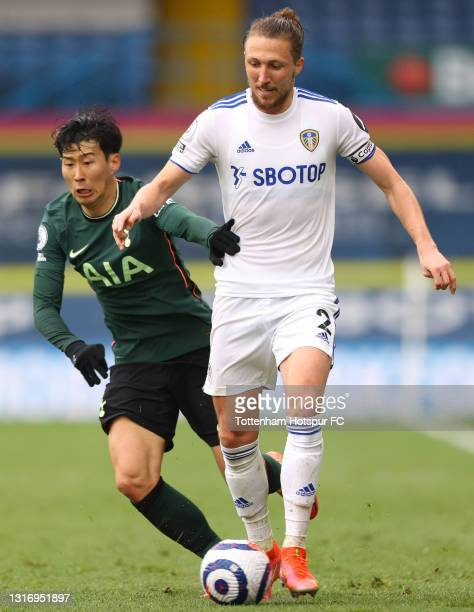 Luke Ayling of Leeds United battles for possession with Son Heung-Min of Tottenham Hotspur during the Premier League match between Leeds United and...