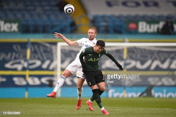 Luke Ayling of Leeds United competes for a header with Son Heung-Min of Tottenham Hotspur during the Premier League match between Leeds United and...