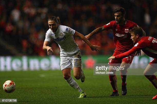 Luke Ayling of Leeds United escapes from Marlon Pack and Luke Freeman of Bristol City during the Sky Bet Championship match between Bristol City and...