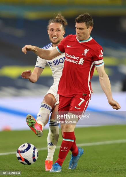 Luke Ayling of Leeds United is challenged by James Milner of Liverpool during the Premier League match between Leeds United and Liverpool at Elland...