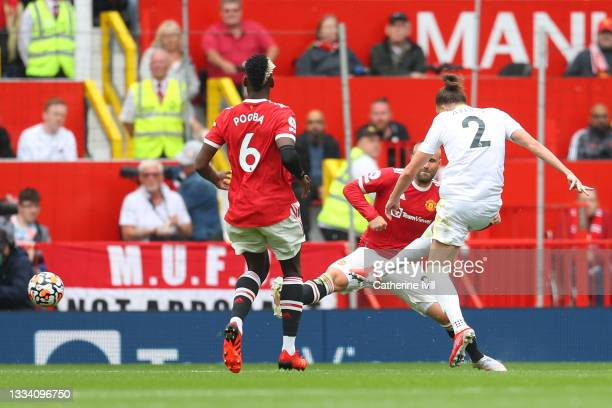 Luke Ayling of Leeds United scores their side's first goal during the Premier League match between Manchester United and Leeds United at Old Trafford...