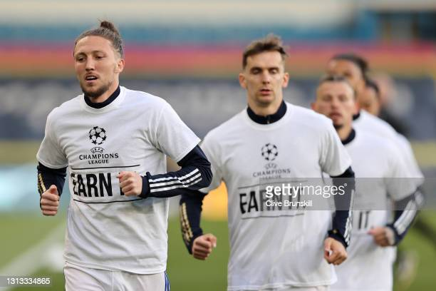 Luke Ayling of Leeds United warms up while wearing a protest t-shirt against the European Super League prior to the Premier League match between...