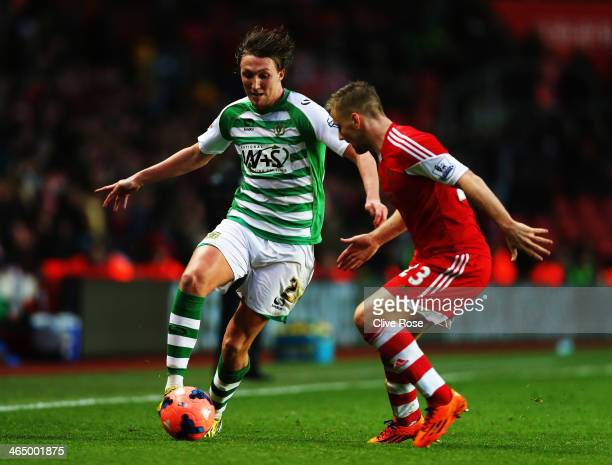 Luke Ayling of Yeovil Town holds off the challenge of Luke Shaw of Southampton during the FA Cup Fourth Round match between Southampton and Yeovil...