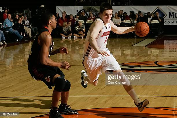 Luke Babbitt of the Idaho Stampede moves the ball against Brian Hamilton of the Utah Flash at Qwest Arena on December 11 2010 in Boise Idaho NOTE TO...