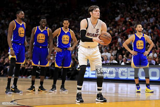 Luke Babbitt of the Miami Heat shoots a technical free throw during a game against the Golden State Warriors at American Airlines Arena on January 23...