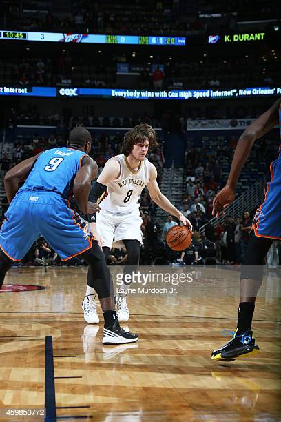 Luke Babbitt of the New Orleans Pelicans handles the ball against the Oklahoma City Thunder during the game on December 2 2014 at the Smoothie King...