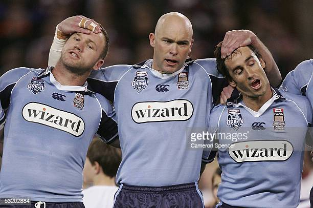 Luke Bailey Ben Kennedy and Andrew Johns sing the National Anthem during game three of the ARL State of Origin series between the Queensland Maroons...