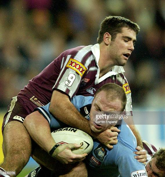 Luke Bailey of the Blues is tackled by Cameron Smith of the Maroons during game three of the NRL State of Origin Series between the Queensland...