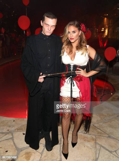 Luke Baines and Cassie Scerbo attend Just Jared's 6th Annual Halloween Party on October 27, 2017 in Beverly Hills, California.
