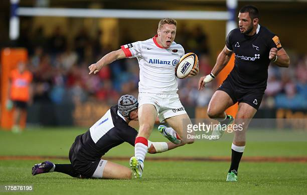 Luke Baldwin of Saracens charges upfield in the match against Newcastle Falcons during the JP Morgan Asset Management Premiership 7's Series Finals...