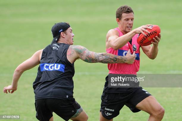 Luke Ball is tackled by Dayne Beams during a Collingwood Magpies AFL training session at the Southport Football Club on February 26 2014 on the Gold...