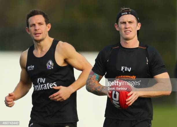 Luke Ball looks on as Dayne Beams of the Magpies runs with the ball during a Collingwood Magpies AFL training session on June 17 2014 in Melbourne...