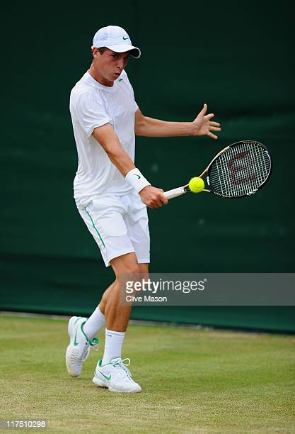 Luke Bambridge of Great Britain in action during his first round boy's match against Andrew Whittington of Australia on Day Seven of the Wimbledon...