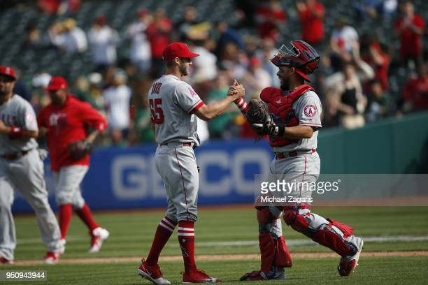 Luke Bard and Rene Rivera of the Los Angeles Angels of Anaheim celebrate on the field following the game against the Oakland Athletics at the Oakland...
