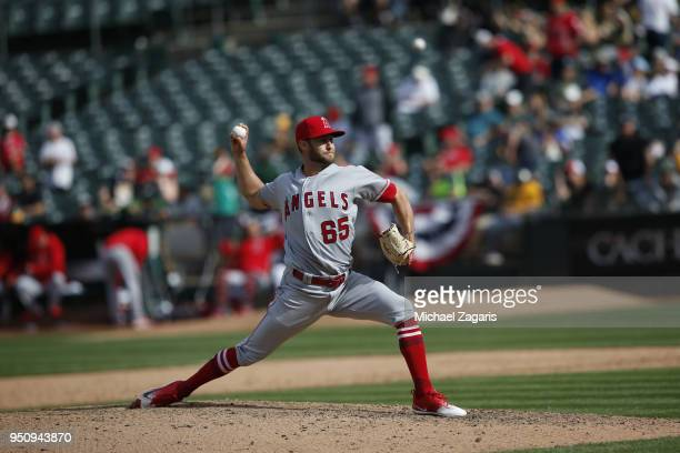 Luke Bard of the Oakland Athletics pitches during the game against the Los Angeles Angels of Anaheim at the Oakland Alameda Coliseum on March 31 2018...