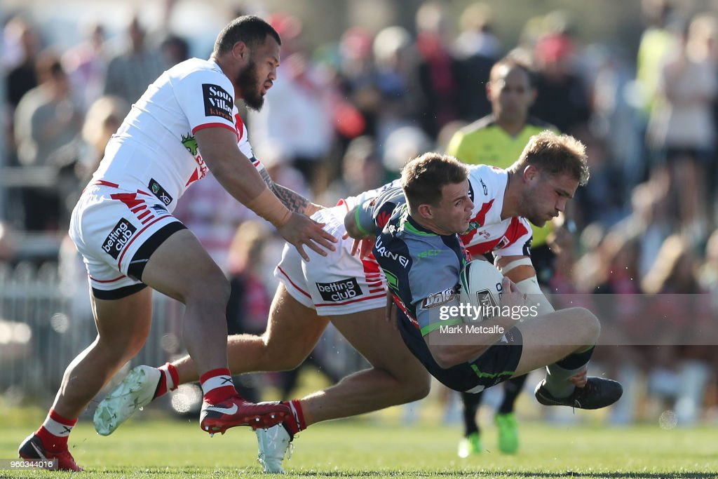 Luke Bateman of the Raiders is tackled during the round 11 NRL match between the St George Illawarra Dragons and the Canberra Raiders at Glen Willow Sporting Complex on May 20, 2018 in Mudgee, Australia.
