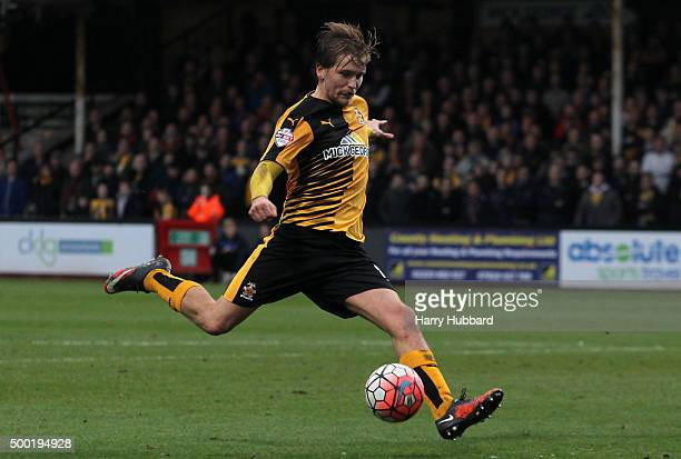 Luke Berry of Cambridge United in action during the Emirates FA Cup Second Round match between Cambridge United and Doncaster Rovers at Abbey Stadium...