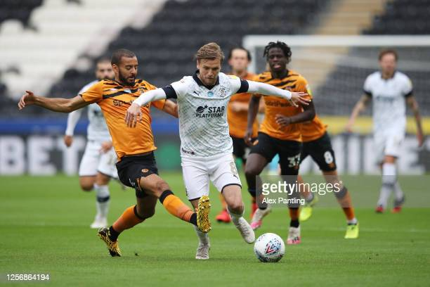 Luke Berry of Luton Town battles for possession with Kevin Stewart of Hull City during the Sky Bet Championship match between Hull City and Luton...