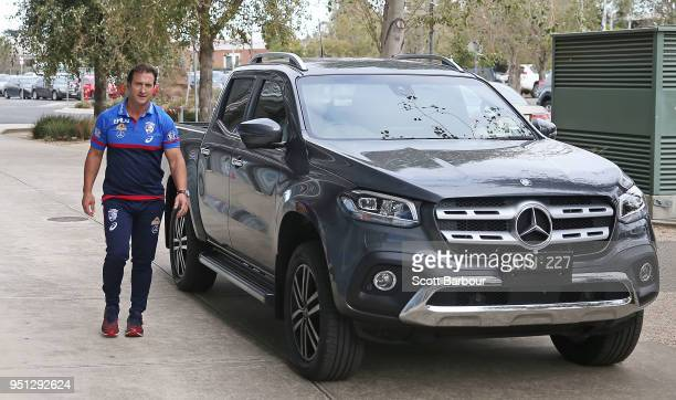 Luke Beveridge coach of the Bulldogs arrives in a car to speaks to the media during a Western Bulldogs AFL training session at Whitten Oval on April...