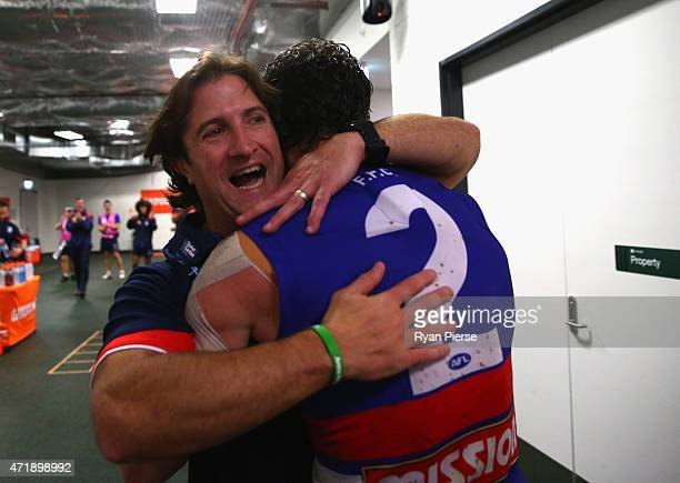 Luke Beveridge coach of the Bulldogs celebrates with his players after the round five AFL match between the Sydney Swans and the Western Bulldogs at...