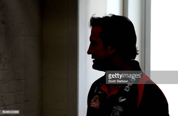 Luke Beveridge coach of the Bulldogs is silhouetted as he arrives to speak to the media during a Western Bulldogs AFL training session at Whitten...