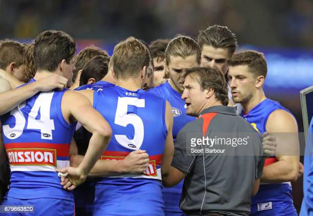 Luke Beveridge coach of the Bulldogs speaks to his team during a quarter time break during the round seven AFL match between the Western Bulldogs and...