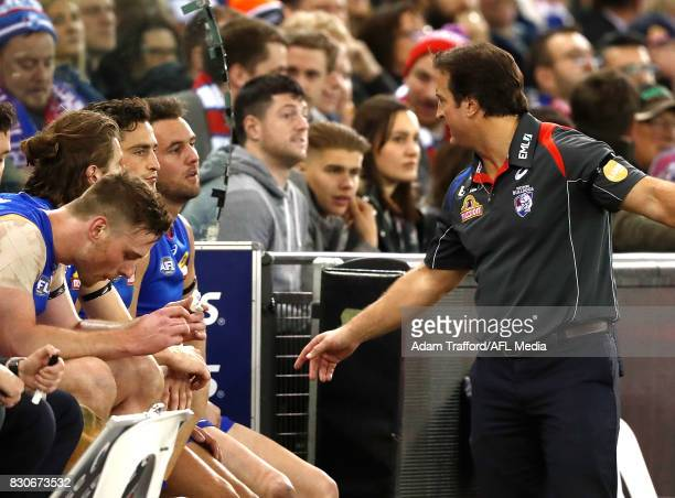 Luke Beveridge Senior Coach of the Bulldogs addresses his players on the interchange bench during the 2017 AFL round 21 match between the Western...