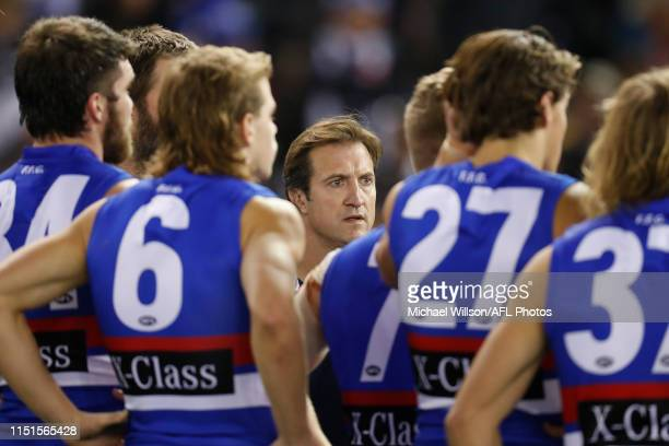 Luke Beveridge Senior Coach of the Bulldogs addresses his players during the 2019 AFL round 14 match between the Western Bulldogs and the Collingwood...