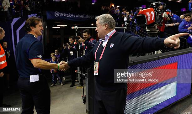 Luke Beveridge Senior Coach of the Bulldogs and President Peter Gordon shake hands during the 2016 AFL Round 21 match between the Western Bulldogs...