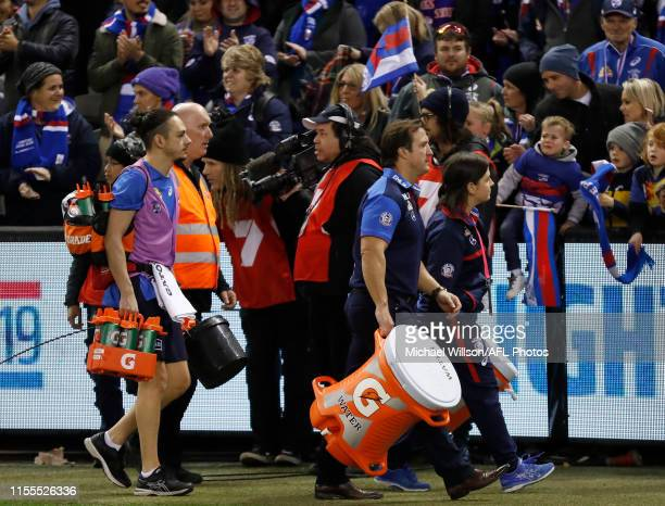 Luke Beveridge Senior Coach of the Bulldogs carries a Gatorade esky during the 2019 AFL round 17 match between the Western Bulldogs and the Melbourne...