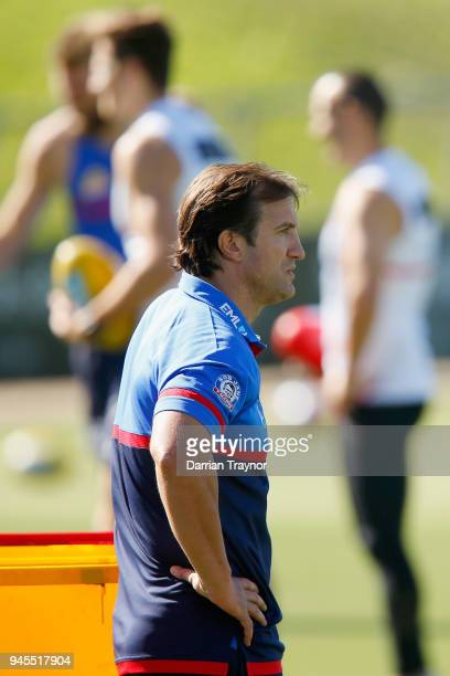 Luke Beveridge Senior Coach of the Bulldogs looks on during a Western Bulldogs AFL training session at Whitten Oval on April 13 2018 in Melbourne...